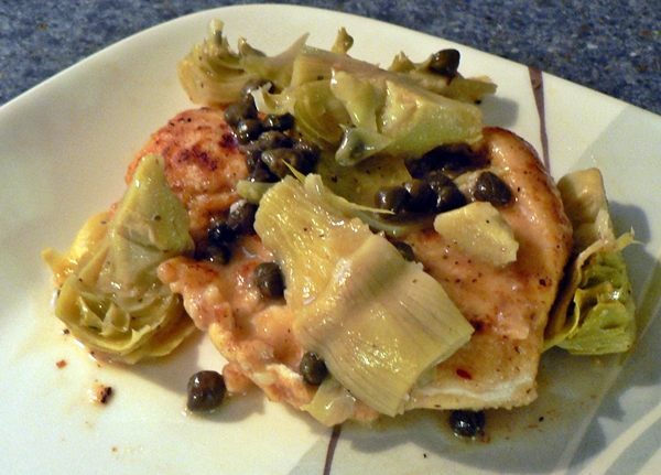 ... , with a lemony white wine sauce, topped with artichokes and capers